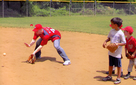 Washington National Brian Bixler takes grounders at Home Run Baseball Camp