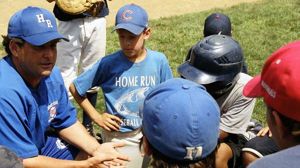 Coach Mac speaking with kids